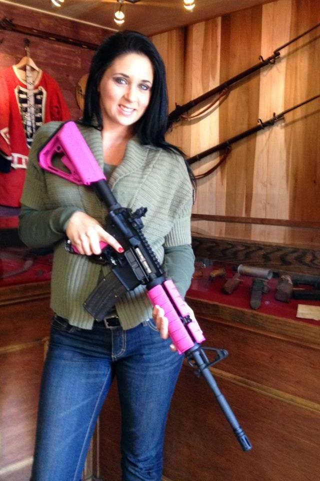 Woman holding pink gun
